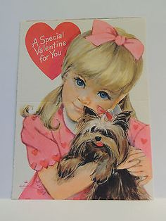 Blonde girl with pink bowl Hugging Yorkshire Terrier