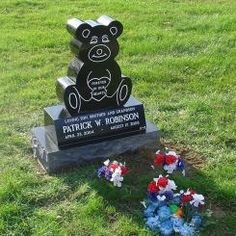 A child upright monument for the Robinson family, made from Absolute Black granite. Located in Woodvale Cemetery in Middleburg Heights, Ohio. Flat Grave Markers, Middleburg Heights, Memorial Markers, Robinson Family, Cemetery Monuments, Black Granite, Ohio, Stones, Memories