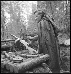 A tired Finnish soldier with his Suomi KP during the Continuation War (1944)