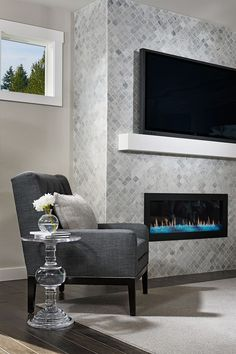 Floor to Ceiling Tile. White & Grey Tile Fireplace. Hour glass shaped Tile.