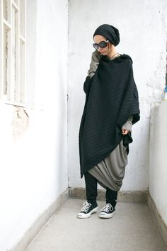Extravagant Poncho / Knit Cotton Asymmetric Hoodie Your warm Fashion Challenge !!!You Best way to express your style ! Available in Black & Grey Be Original and UNIQUE and Dare to WEAR... Different sizes available S,M,L,XL Because of the loose design the most important here are bust an