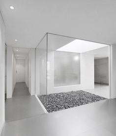 Voids, skylights, outdoors to indoor. Reminiscent of a house in Palm Springs. too white.