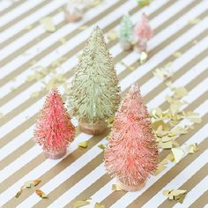 Add a touch of gold to some tiny bottle brush trees this Christmas!