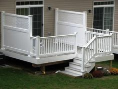 Vinyl #deck with AZEK Building Products  slate grey flooring, white PVC railing and 6' privacy panels