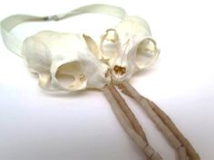 Rebecka Huusko Källman Necklace: Missan & Tusse, 2014 Cat bone, chicken bone, bioresin, cooking string, sterling silver, ribbon - Ädellab, Konstfack: Degree Exhibition 2014