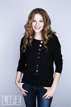 Love this sweater. Simple black, with great button details.  Rachelle Lefevre