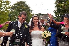 Bride and groom showered with confetti | Photography by www.colinmurdochstudio.com