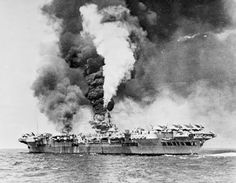 HMS FORMIDABLE on fire after she was struck by a Kamikaze pilot off Okinawa on May 4, 1945. Formidable was part of the 1st Carrier Squadron and launched her planes repeatedly to bombard Japanese positions. Despite serious damage, Formidable remained under her own power and, o May 31, reached the Captain Cook Dock at the Garden Island Dockyard for repairs.