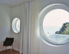 Round Window Covered With Curtains