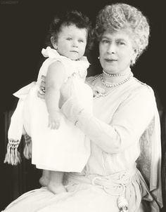 Queen Mary holding her granddaughter, Princess Elizabeth (later Queen Elizabeth II), ca. 1927.
