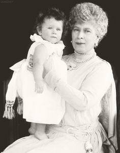 Queen Mary holding her granddaughter, Princess Elizabeth (later Queen Elizabeth II), circa 1927.