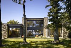 A Modernist inspired lakefront residence on Chicago's North Shore with clean, Contemporary interior design by Steve Kadlec. Residential Architecture, Contemporary Architecture, Architecture Design, Lakefront Homes, Stone Houses, Exterior Design, House Design, Lake Michigan, Villas