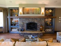 Designed by Shane Inman, this is contemporary living room decorating ideas. This custom-designed stone fireplace has an upper niche with lights for artwork and is flanked by custom-designed shelving that has storage for firewood.