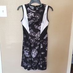 Prabal Gurung for Target Dress Sweet and lovely dress that's versatile. The black and white inserts are a silky/satin material and the skirt is more full than it shows just on the hanger. Flattering fit and back zip. Prabal Gurung for Target Dresses Midi
