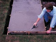 DIYNetwork.com has instructions on how to lay a concrete slab.