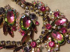 Watermelon necklace and clip on earrings. 1960s. $690.00.