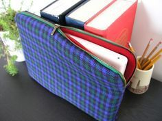 DIY Sewn Electronics Sleeve. Since I picked up sewing recently (this weekend, yay), I've been looking for easy projects. I love that the sleeve is lined and the fabric is customizable. My macbook bag needs replacing and this looks lightweight.