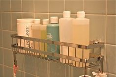 We've finally had it with those bathroom storage shelves with suction cups that just don't stay up!  Ok, so yes we do put some heavy things in them, but after re-suctioning our lilting corner wire baskets for the gazillionth time, we gave up and replaced them with a more permanent (and stylish!) solution.  Our new shower caddy took only a few minutes to install with a tile drillbit, and now we wish we had done this years ago...