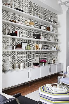 use for the tv wall...minus that wallpaper and have the shelves diffirent heights