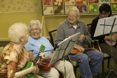 (l-r) Sue Jessup, Norma Schlesinger, George Fortenberry, and Julie Hill of the Bell Trace Ukulele Club. Photo by Tyagan Miller