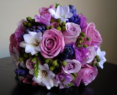 Bridesmaid bouquet of roses, hyacinth, freesia, berry and sweet pea