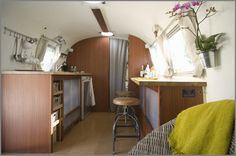 BIG SUR AIRSTREAM RENOVATION: Here's the custom-built galley kitchen and bar. They installed new mahogany laminate to match the original furniture. Brandes designed the ceiling lights, and Area 63 fabricated and installed them.