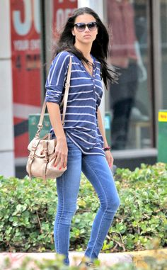 Adriana Lima proves you can't go wrong with classics, pairing a timeless striped top with blue jeans.