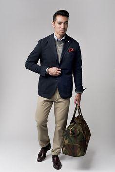 camo duffle with traditional blazer over khakis