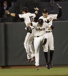 San Francisco Giants' Angel Pagan, Gregor Blanco and Hunter Pence celebrate a 6-3 win over the Colorado Rockies during a baseball game on Tuesday, Sept. 18, 2012