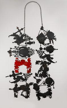 """Shadows"" necklace - by Vera Siemund, steel, and enamel."