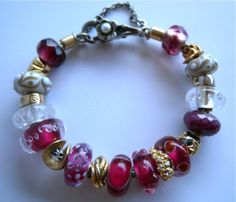 Does it get prettier than this?  I don't think so.  N.O.'s stunning gold and raspberry Trollbeads bracelet.