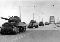 The first few British tanks cross the Nijmegen bridge after it was captured by the US 82nd Airborne Division. #WW2