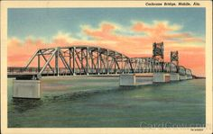 Mobile AL Cochrane Bridge Cochrane Bridge across the headwaters of Mobile Bay, erected at a cost of $2,500,000.00 crosses the mouth of 5 rivers emptying into Mobile Bay. It is an important link in the Old Spanish Trail - connecting Mobile, Ala. with Pensacola, Florida. The center span is one block long and lifts vertically, 135 long above the water allowing the largest of ocean going vessels to pass. It is not a toll bridge, but a free bridge