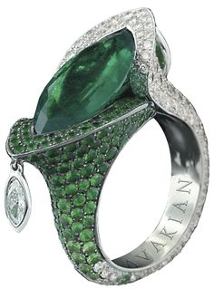 AVAKIAN - A striking avant-garde emerald and diamond ring.