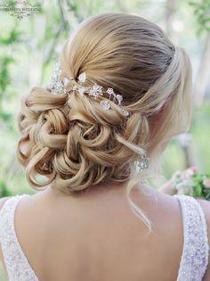 updo wedding hairstyle idea; via Websalon Weddings