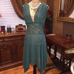 Emerald green nightgown Victoria's Secret nightgown with sheer fabric and lace around waistline. Deep v neck back and front. So sexy and beautiful. In perfect condition. Victoria's Secret Intimates & Sleepwear Chemises & Slips
