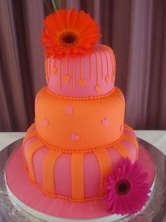 Orange pink daisy flowers pearls spilt paint effect tiered beautiful unique creative wedding/birthday cake