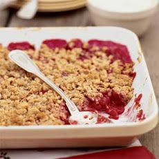 Raspberry-Rhubarb Crisp Recipe - 1 cup rolled oats, 1/2 cup all-purpose flour, 1/2 cup finely chopped walnuts, 1/2 cup brown sugar, 1/2 teaspoon ground cinnamon, 1/2 teaspoon ground ginger, 1/8 teaspoon salt, 1/2 cup cold butter [cut into chunks], 12 ounces rhubarb [about 3 stalks], 3/4 cup granulated sugar, 2 tablespoons cornstarch, 4 cups raspberries [rinsed and drained]