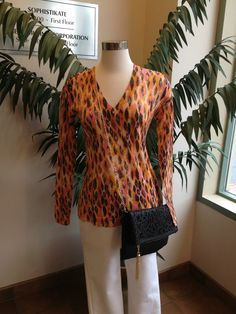 The Elanora sweater by Emu with Cluny capris and a cutout clutch by Pola!