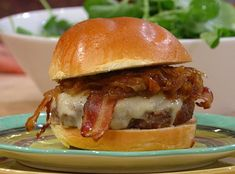 Rachel Ray's Double-Bacon Burgers with Maple-Worcestershire Onions...  saw this in her magazine while waiting for my son at the ortho. Made it tonight for dinner. My husband calls it the best burger he's ever had. No kidding. Note: he added a couple of sliced jalapeños pieces on his - a perfect mix of spicy and sweet. Also, I didn't have apple cider on hand so I used apple sauce instead - yummo!