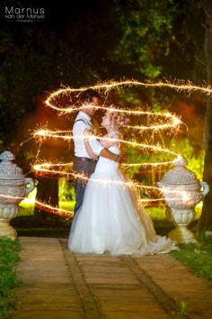 First shot from this weekends wedding. Had loads of fun with this couple. Some people just need a hint to go into a series of poses, and these two were naturals.  Sparklers with long exposure and flash.