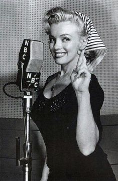 I won't be satisfied until people want to hear me sing without looking at me. ~Marilyn Monroe