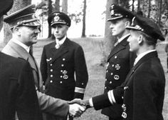 The Führer greets and awards the Knight's Cross of the Iron Cross with Oak Leaves to the heroes of KriegsmarineUboat commanders Heinrich Liebe of U-38Herbert Schultze of U48 and Engelbert Endrass of U46