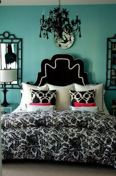 Painted chandelier, Black upholstered headboard, turquoise walls... black and white bedding...