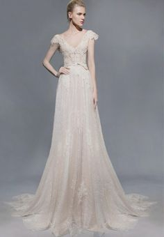 Love the sweet lace sleeves on this Victoria KyriaKides wedding dress