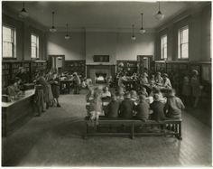 Riverdale Branch - Carnegie Library - Toronto Public Library - circa 1927 (twenties) interior showing Boys / Girls / Children's department - notice roaring fire in background - see also the Wychwood and High Park photos from the same era showing children's departments.