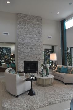 Contemporary Living Room with Floor to ceiling light grey stacked stone fireplace.: