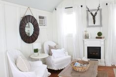 Love this neutral family room with lots of texture eclecticallyvintage.com