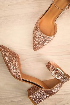 Tairano Quartz #boutique1861 / These trendy block heeled shoes are exquisite and sparkly. The pointed toe make them at the height of style, while the ankle strap and low heel ensure your comfort all night long. No matter the season, no matter the occasion, you'll be able to put your best foot forward.