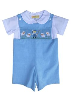 An adorable hand smocked little boy blue adorns this overall along with his four sheep on a beautiful light blue shortall. This shortall is sleeveless with buttons at the shoulders and snaps on the le